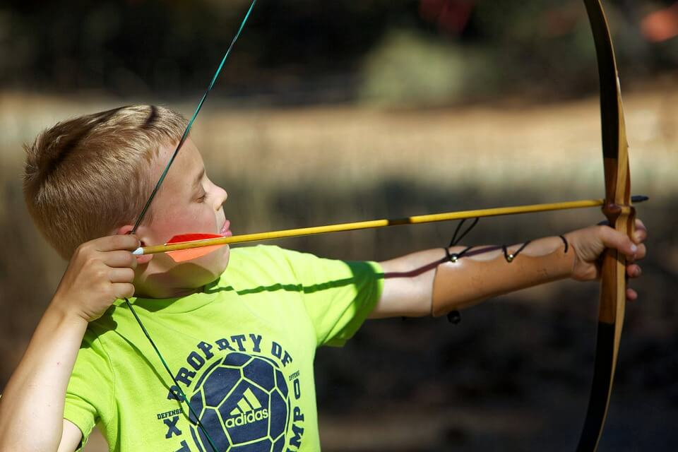 kids shooting bow and arrow